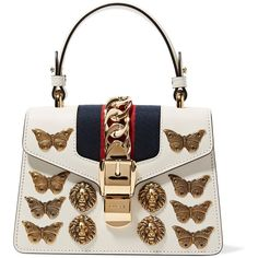 Gucci Sylvie mini embellished chain-trimmed leather and canvas... (€2.470) ❤ liked on Polyvore featuring bags, handbags, shoulder bags, white leather shoulder bag, canvas shoulder bag, genuine leather shoulder bag, cell phone shoulder bag and white leather purse