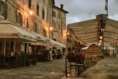 Gateway cafe at dusk - Motovun, Croatia    via ysvoice: classy-in-the-city: goingtomakeitmine