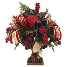 """Faux cedar and fruit arrangement in a pedestal planter with fluted detailing.  Product: Faux floral arrangementConstruction Material: Silk, plastic, nylon, and resinColor: Red, green, and goldDimensions: 17.5"""" H x 20"""" Diameter"""