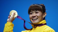 Maiya Maneza of Kazakhstan celebrates on the podium with the gold medal after winning the women's Weightlifting final on Day 4 of the London 2012 Olympic Games at ExCeL. 2012 Summer Olympics, Olympic Gold Medals, Summer Games, Kazakhstan, Olympians, Olympic Games, Weight Lifting, Good News, Athlete