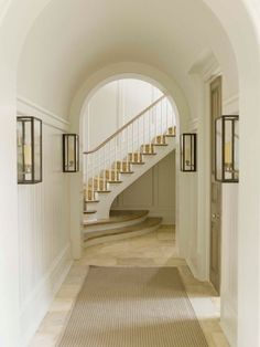 House Tour: Stunning in Stone – Design Chic Design Chic – Decorating Foyer Entry Stairs, Entry Hallway, Hallway Sconces, Entry Tile, White Hallway, Foyer Staircase, Hallway Walls, Long Hallway, Basement Stairs