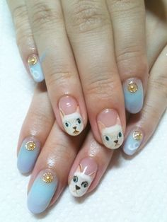 blue nails with white kitty and gold crystals so cute!