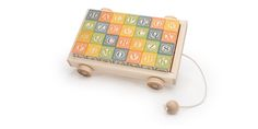 CLASSIC ABC BLOCKS WITH WAGON $56.00    28 - 1.75 INCH BASSWOOD CUBES (44 MM) STURDY BASSWOOD PULL WAGON TOY CONTAINS A SMALL BALL. AGES 3+ Give teddy bear and dolly a ticket to ride. Our ABC Flyer is a classic way to store blocks, and is much more than a toy organizer, it's a toy in and of itself. In addition to holding a full set of our standard 28 ABC blocks, it can also serve as a wagon for your children to pull their other toys around in.