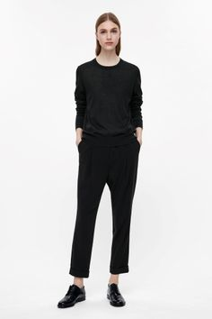 COS image 1 of Round-neck wool jumper in Black