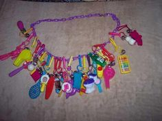 Vintage Retro 80's Plastic Bell Clip Charm Necklace. I still have some of these somewhere...