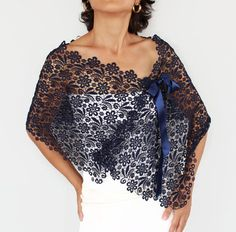 This lace stole is made of ultramarine (dark navy blue) cotton lace fabric. Its tied with satin ribbon lacings, which gie it an air romantic. Beside these wide ribbons, also thin ribbons were added inside part of the stole, to get a neat look. Also a thin ribbon is added to the neck part for any shoulder size adjustment. This modern bridal shrug with satin ribbon lacings, you can create your own style with this complementary accessory having such a modern, minimal yet rich look. Its my ...