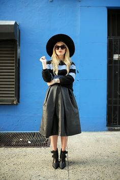 brimmed hat with black outfit