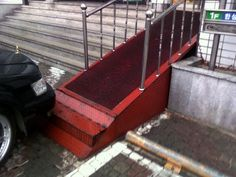 Selfish parking aside, the inclusion of steps at the foot of this wheelchair ramp is baffling to say the least.
