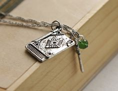 """Legend of the Seeker Necklace- Richard Cypher, Kahlan Amnell.  The Book of Counted Shadows from Wizards First Rule, first book of """"The Sword of Truth"""" series by Terry Goodkind."""