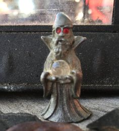 A personal favorite from my Etsy shop https://www.etsy.com/listing/535848081/vintage-spoontiques-pewter-wizard-red