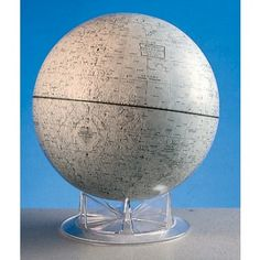 """Moon Globe  The Moon is recreated in masterful detail with this official NASA model. 12"""" dia. globe designates the first American and Russian unmanned landing sites and the first Apollo manned landing location.  Detail of craters, seas, mountains and plains gives this globe a striking three–dimensional effect. 15"""" overall height. Developed under the auspices of NASA. Includes the Story Of The Moon handbook and study projects."""
