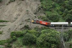 A freight train carrying milk to Taranaki hit a landslide in the Manawatu Gorge. Environmental Studies, New Zealand, Country Roads, Ocean, Trains, News, Diesel, Milk, Google