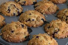 Oatmeal Streusel Blueberry Muffins - crunchy straight out of the oven, these muffins are brightened up with a secret ingredient - lemon zest!