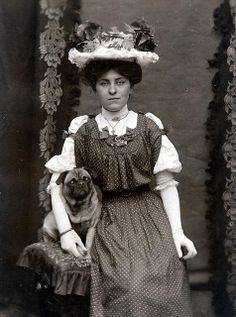 1900's~  she's so tenderly holding his paw...