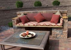 Great step-by-step instructions and video, How to Build an Outdoor Couch (from Allen Block), but could also be done with cinder block and some spray paint or water-based concrete stain