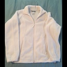 Columbia white fleece zip-front jacket Full zip front with 2 zippered pockets and adjustable elastic waste band. Elastic cuff sleeves. Excellent condition. Gently worn with no apparent stains or flaws. Perfect lightweight jacket. Columbia Jackets & Coats