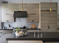 Black and pale wood kitchen