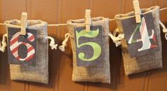 FUN idea!! Advent Calendar with burlap bags decorated clothes by Our Mom's Touch at Etsy #ourmomstouch