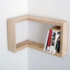 Kulma frame shelf by Martina Carpelan is designed to be hanged either in a positive or a negative corner of a room.