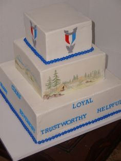 Court of Honor  I liked all my hand painting on this cake. This on is for a boy scout Court of Honor (when they make eagle scout). Mom wanted different scenes on each side: Camping, hiking, mountains, canoeing. Words on bottom are the scout motto, top tier has eagle scout pin (gumpaste) each side.