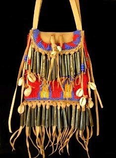 Native American Beaded Bag. The Pouch is made from Braintanned Elk, Tin Cone Fringe, and countless seed beads.