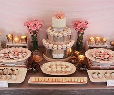 Miniature desserts adorn a metallic silver cake, creating a glamorous wedding dessert table.