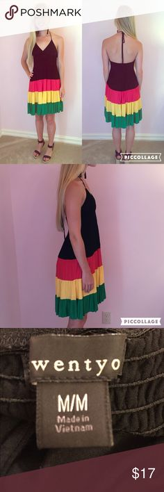 Color Block Sun Dress This is the perfect color blocked sun dress! This dress is made out of a rayon and spandex material making it very high quality yet comfy. It has black, pink, yellow, and green panels along the dress and has two ties to change the length of the neckline. It can easily be dressed up or down! This dress fits true to size (adult medium) and is in great condition (it has only been worn a few times). Forever 21 Dresses Midi