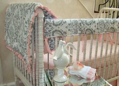 Bumperless Crib Bedding 2 Piece Set Teething Guard and Blanket Pink and Grey Damask. $73.00, via Etsy.