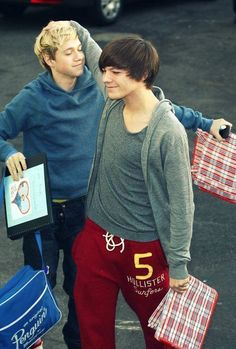 Niall and Louis. Niall has a scrapbook with his face on it. Hahahah