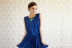 A flirty dress in a bold hue is the perfect vintage-inspired holiday attire. #shopruche #ruche