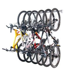 Bicycle Storage is easy with this garage bike rack from Monkey Bars. It's the only bike rack that will hold 6 bikes in 4 feet. Garage Storage Racks, Bike Storage Rack, Garage Organization, Organized Garage, Organizing Ideas, Easy Storage, Kitchen Storage, Organizing Solutions, Storage Hooks