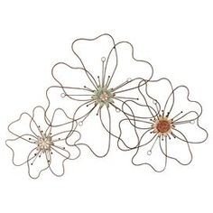 """Set of three openwork floral wall accents.Product: 3 Piece wall décor setConstruction Material: MetalColor: Brown, blue and orange   Dimensions: 37"""" H x 25.75"""" W x 2.5"""" D (overall)"""