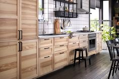 A kitchen with natural ash doors and drawers. Natural Ash cabinetry from IKEA - TORHAMN - w/ black iron BORGHAMN hardware