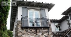 Custom French Door Architectural Shutters Atop a Iron-Forged Balcony traditional exterior