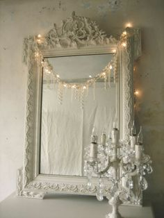 paint an old frame white and put in a mirror!