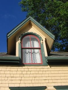 Detail photo of window on the Mackintosh home at Victoria, Prince Edward Island, Canada.