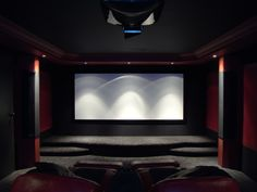 "Home theater. Love the ""clean and classy"" look. On the sides I want dark curtains. That way we could store our movies alphabetically around the room in shelves behind the curtains, and they wouldn't even have to be seen."