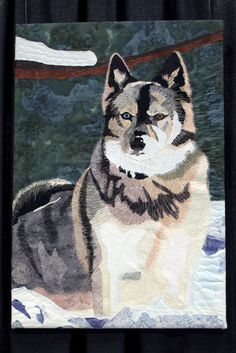 Athena Goddess of Snow by Vikki Zulpo.  2nd place, small art quilt, Ottawa Valley Quilters Guild, 2011 show.  Inspired by a photo of her son's Norwegian elkhound, Athena.