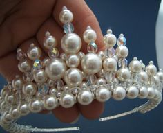 measures 2 inches at its highest point and has been created using 6mm, 8mm, 10mm and 12mm white glass pearls and 6mm crystal AB.