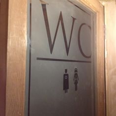 Toilet door BatMan and Wonder Woman  Photo by : Minnie Reed