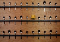 Dedicate part of your wall to long pieces of wood with spoons ... Each spoon holds an upside-down mug! Cute and space-saving :)