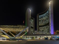 Toronto City Hall A night view of Toronto City Hall designed by Finnish architect Viljo Revell and built in 1965 looking across Nathan Phillips Square.  This image is a blend of a pair of hand-held shots separated by 3 stops assembled in Lightroom 6.