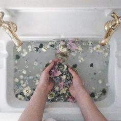 rainbow petals in water in vintage sink