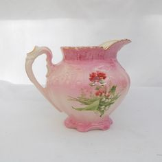 Very beautiful pink porcelain pitcher with gold trim .  It is marked RS Prussia on bottom with red star .  No fractures of repairs . 6 1/4