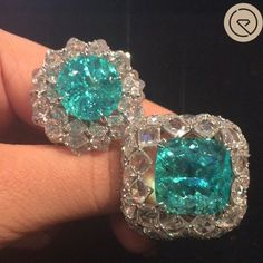 Holding two rare Paraiba Tourmalines with such spectacular colours from karen suenfine jewellery