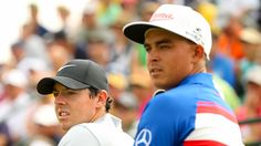 Rory McIlroy, left, and Rickie Fowler wait to tee off on the third hole during Thursday's first round.