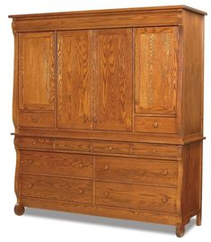 Amish Old Classic Sleigh Two Piece Deluxe Mule Chest Here's the chest to use as a magnificent stand alone closet. Full of drawers, doors, cabinet space and fine Amish craftsmanship. Curvy, charming and cut to perform for decades. Built by hand in choice of wood, finish and hardware. #Amishbedroomchest #bedroomchest #mulechest #bedroomstorage
