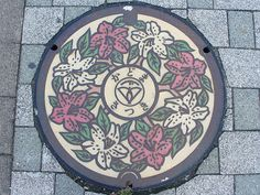 Kadoma city, Osaka pref manhole cover(大阪府門真市のマンホール), via Flickr. Embroidery pattern?