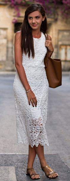 Larisa Costea is wearing a white crochet dress from Sheinside, tote from Michael Kors and the sandals are from ASOS