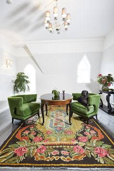 traditional carpet from moldavia. Art Deco armchairs in green.